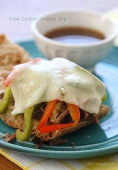 If the thought of a hot sandwich filled with beef, melted cheese, caramelized onions and peppers served with beef broth for dipping sound appealing, you NEED to make these! These sandwiches make the perfect game day meal, start this early in the morning because you'll need 9 to 12 hours, depending on the size of your roast. You can even serve them as sliders by serving them on dinner rolls. Ever since I got my hands on the The Recipe Girl Cookbook: Dishing Out the Best Recipes for Enterta...