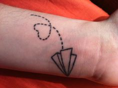 Everyone has been complimenting me on my tattoo since I got it, so I decided to show the Pinterest world. This tattoo describes the last year of my life, I have been floating lightly through life, just as a paper airplane does when you finally let it out of your hands. It also describes my wanderlust attitude. I don't have a final destination, but where my heart takes me I will go. I had this tattoo done on my 22nd birthday, and out of the 6 tattoos I have, this is my favorite.