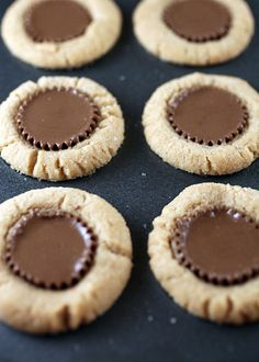 Chocolate Candy Cookies    1 1/2 cups all purpose flour  3/4 teaspoon baking soda  1/2 teaspoon salt  1/2 cup butter, slightly softened  1 cup peanut butter  1 cup sugar  1 egg  2 teaspoons vanilla  Hershey's Kisses or Reese's Peanut Butter Cups, or both