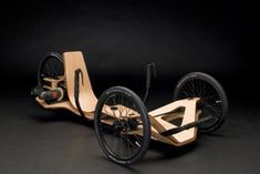 Beautifully moulded wooden bike powered by an electric drill. Brilliant!