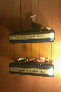 Shelves made from valve covers in Kevin's room- easy DIY!  We also mounted a Hummer grill over the windows.