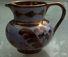 Old Castle England copper lustre & blue pottery pitcher.