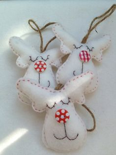 Reindeer Christmas Decorations @ Folksy: These lovely little White felt reindeer will look so festive on your tree this year. Handmade with decorative button noses and hessian to hang them.