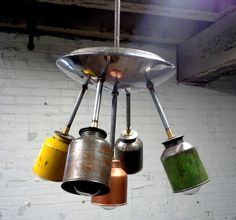 made this unique pendant ceiling fixture using a vintage 1946 Chevrolet hubcap and vintage oilier's. I incorporated brass elements to give i...