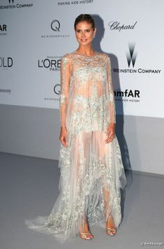 Heidi Klum porte une robe transparente signée Marchesa, au gala de l'amfAR, lors du Festival de Cannes 2012.