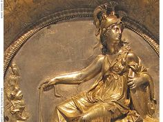 A relief of Athena / Minerva and her owl on a gold-plated silver plate. 2nd century BCE