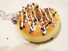 Squishy Donut Necklace. Sprinkle and Syrup Drizzle. on Etsy, $11.44 CAD