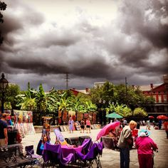 Artists in Jackson Square in New Orleans with stormy skies....my favorite kind of day in the Quarter....open up the French doors and let the cool breeze come in until the rain starts....I miss those days....