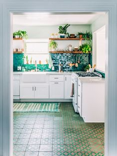 7 Dreamy Kitchen Before and Afters - The Effortless Chic- White Kitchens, Quartz Kitchens, Brass Pendants, Ceramic Pendants, Bar stools, Green Cabinets, Painted Cabinets, Backsplash