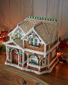 Porch Gingerbread House Peppermint Porch Gingerbread House - Horchow Yeah, umm I can do this.Peppermint Porch Gingerbread House - Horchow Yeah, umm I can do this. Gingerbread Village, Christmas Gingerbread House, Noel Christmas, Christmas Goodies, Gingerbread Man, Christmas Treats, Christmas Baking, Gingerbread Cookies, Christmas Decorations