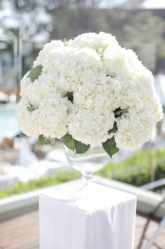 This beautiful floral arrangement of hydrangeas is sure to take anyone's breath away.