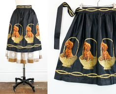 Novelty print apron featuring adorable Cocker Spaniel puppies in straw baskets by VoyeurVintage on Etsy