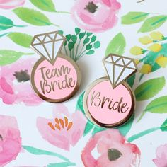 These cute team bride cardboard badges from Tiger Feet Creations are so much more stylish than your average hen party badges - we are obsessed! If some of the bridal party are only just getting to know each other, then a badge with the person's name and position (mother of the bride, bridesmaid, head bridesmaid etc) is a great way to break the ice. #henpartybags #henparty #hendo #bacheloretteparty #bachelorette #bachelorettepartyideas #henpartyideas #henpartybagfillers #bags #bride #wedding…