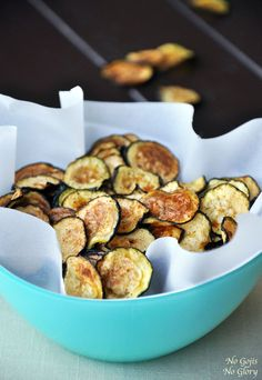 Zucchini Chips Preheat oven to 260 degrees Fahrenheit. Prepare 2 large baking sheets by lining with parchment paper. Place sliced zucchini i...