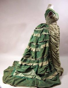 Dress, 1874-6. Side view. Nice view of the bustle silhouette.