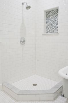Master shower design with subway tiles backsplash, hexagon tiles floor, polished nickel shower set and blue mosaic tiles. White Subway Tile Shower, Mosaic Shower Tile, Subway Tile Showers, Shower Tile Designs, Marble Showers, Bathroom Floor Tiles, Subway Tiles, Mosaic Tiles, Hex Tile