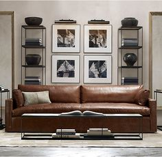 RH's Belgian Track Arm Leather Sofa:Our European-inspired take on the classic sofa redefines it for a new age. Low to the ground, deep in profile, and sleekly streamlined for sophisticated appeal, it's a chic, ultra-comfortable twist on tradition.