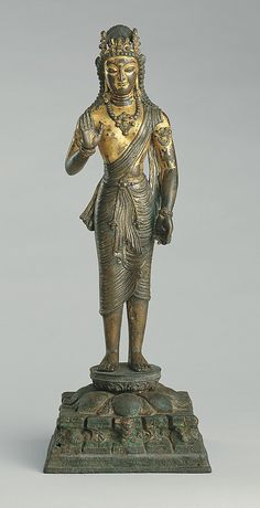 Standing Bodhisattva Maitreya -     Date:      ca. 7th century  Culture:      India (Jammu & Kashmir) or Pakistan (ancient kingdom of Kashmir)  Medium:      Copper alloy, gilded and silvered, inlaid with silver