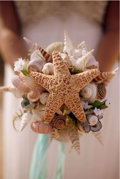 I don't plan on carrying a bouquet, but this is pretty :) .DIY Beach Wedding Inspiration Idea - Try your hand at creating this easy shell bouquet for your beach wedding! Beach Wedding Bouquets, Wedding Flowers, Wedding Beach, Seashell Wedding, Bridal Bouquets, Gold Wedding, Boquet, Wedding Centerpieces, Summer Wedding