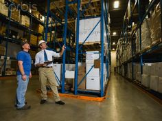 Warehouse workers checking inventory