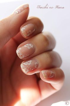 Lace nails. This would be pretty on your wedding day. It would look good with the dress and isn't too bright or flashy.