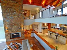 Exposed brick fireplace and double volume living space!