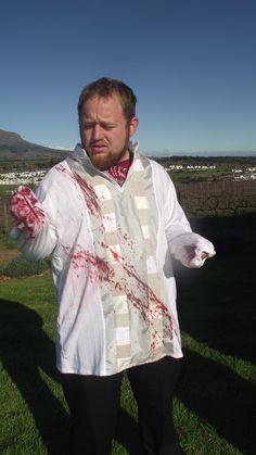Macbeth ( Lodewyk Ludik), being splattered with stage blood.