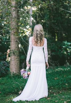 Long lace sleeve wedding dress with stunning low by Graceloveslace