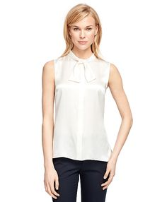 Our blouse is crafted in pure silk charmeuse with a self bow at neck. Covered placket with shell buttons down center front. Bow Blouse, Shirt Dress, Shirt Blouses, Shirts, Silk Charmeuse, White Tank, Work Fashion, Blouses For Women, Brooks Brothers