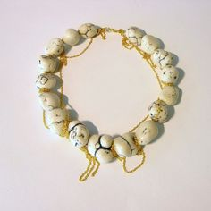 statement necklace, white clumps of howlites with gold chains