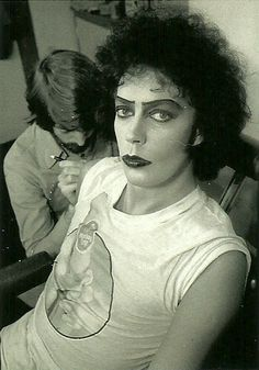 Tim Curry, as Dr. Frankenfurter, from Rocky Horror, getting his Boss tattoo applied (yes, I've done the show enough, drawn that tattoo enough & worn it enough to know exactly what's going on - LOL)