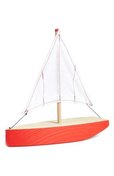 Adore the little cotton-canvas sail on this wooden toy boat.