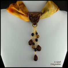 I've been working on a new batch of scarf jewelry designs. These ones are more suitable to hanging on a lighter organza or silk scarf. I a...