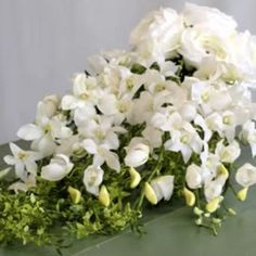 Make your cascading bouquet with this simple DIY video and high-quality silk flowers from Afloral.com.  This video features a gorgeous white orchid and silk ros