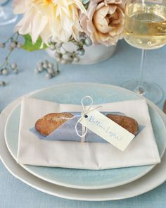 Welcome loved ones to their seats with a feast for the eyes and the taste buds: Miniature baguettes double as seat assignments. For a twist on the classic place card, have your caterer or local bakery make a tiny baguette for every guest. Designate a friend or bridesmaid to pick them up on the morning of the wedding, then wrap them in squares of light-blue parchment paper, attach name tags with twine, and place one atop each table setting.