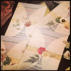 My homemade wedding invitations--I loved how each one was different!  I found the paper wraps at Party City and the paper flowers and gauzy ribbon at Michaels.  Used pearl card stock for a little shimmer. :-)