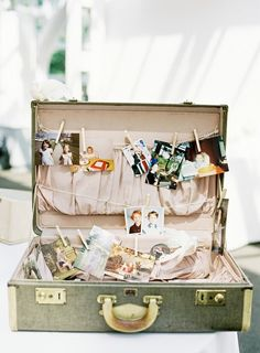 vintage case photo display Did this for my husbands surprise birthdaybut turned the suitcase sideways and attached photos to the back.