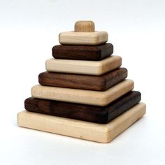 organic SAPLING STACKER - natural wooden developmental toy. This Maple and Walnut Stacking Set promotes imagination while building fine motor skills for both infants and toddlers. The blocks can be arranged in any configuration on the column which allows children to develop creativity and pattern recognition.