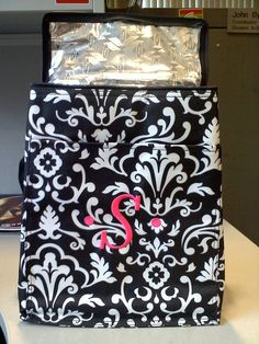 "Picnic Thermal Tote in Black Parisian Pop with ""S"" in Hot Pink - Of course you can use this for a picnic but I use it in the car for traveling and am using it for a gift for a friend's wedding complete with wine bottles (inside it), glasses and their new name printed on it!"