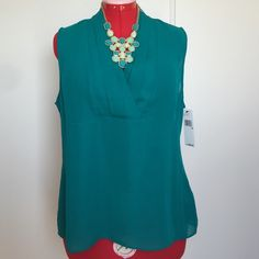Green/bluish DKNY sleeveless v-neck Brand new tags still attached, size 16. 100% polyester. DKNY Tops