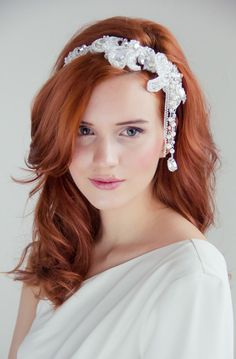 seriously... how stunning is this head piece by Olivia?? http://www.weddingchicks.com/vendor-guide/olivia/