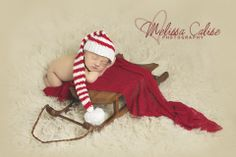 Melissa Calise Photography (Newborn baby boy posing ideas Christmas holiday santa sleigh photo shoot)
