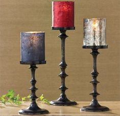 Slim, stacked and smoky perfectly describes this three size set of candlesticks crafted of oxidized iron. Our popular and colorful glass candle holders, not included, work beautifully with these candl. Candlestick Crafts, Candlesticks, Glass Holders, Glass Candle Holders, Living Room Accents, Colored Glass, Decoration, Pillar Candles, Rustic Decor
