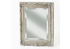 Revive an old mirror by painting it silver and antiquing it with stain
