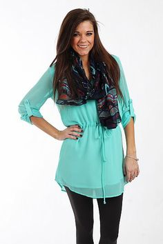 """The Jenna Tunic, Mint $41.00  This top is a necessity for your wardrobe! The sheer top is fully lined with a drawstring waist, mandarin collar, top sleeves and false pocket on the front. Wear it with leggings or skinnies and your favorite scarf or statement necklace!   Fits true to size. Miranda is wearing a small.   From shoulder to hem:  Small - 31""""  Medium - 32""""  Large - 33"""""""