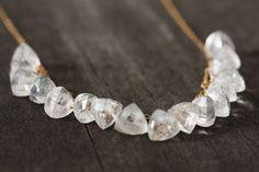 The pictures hardly even captures the sparkle of this rock crystal necklace! The beads are trillion shaped and beautifully faceted to reflect