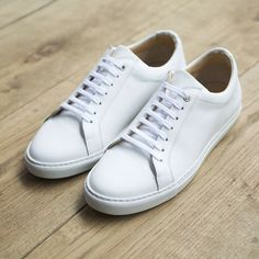 Men's white sneakers. Sneakers happen to be a part of the fashion world for longer than you might think. Present day fashion sneakers bear little similarity to their early predecessors however their popularity is still undiminished.