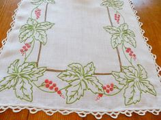 2 red berry runners with green leaves