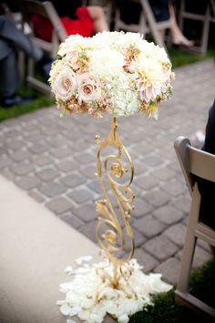 elegant aisle decor with peach and pink floral arrangement #weddingceremony #aisledecor #weddingchicks http://www.weddingchicks.com/2014/01/30/pink-and-peach-bejeweled-wedding/