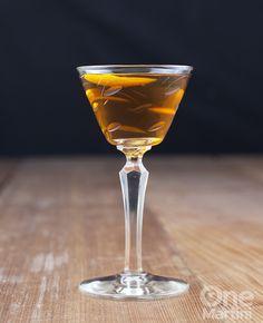 Noci Bruciate - Bourbon, Cocchi Vermouth, Walnut Liqueur, Orange Liqueur, Black Walnut Bitters, Flamed Orange Twist.